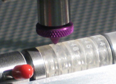 Comco Automated MicroBlasting system serializing lenses