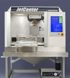 Comco's JetCenter automated microblasting system powered by AccuFlo abrasive blaster