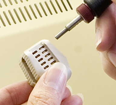Precision deburring: PEEK spinal implant