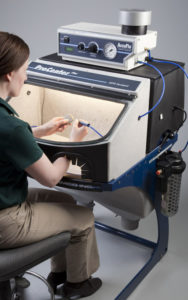 Comco AccuFlo and ProCenter Plus form the Manual MicroBlasting System.