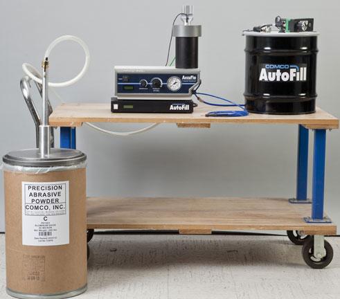 AutoFill automates abrasive tank refills for Comco AccuFlo microblaster